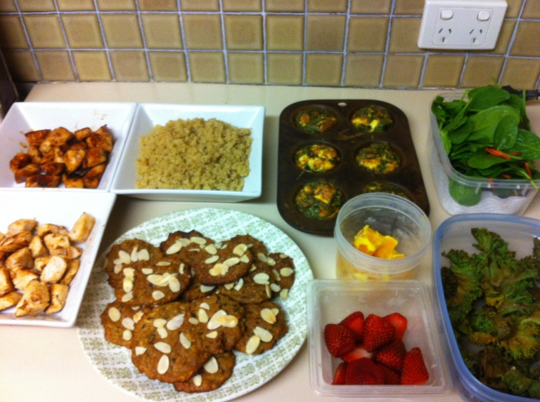 2 kinds of chicken, quinoa, frittata, salad, kale chips, cut fruit and paleo cookes.