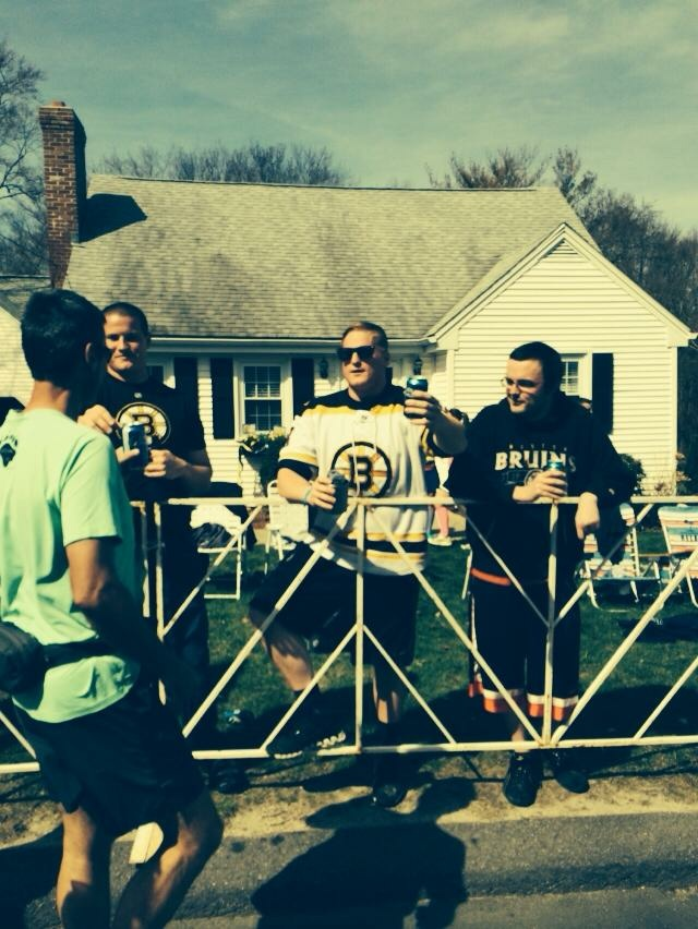 Spectators, including these Boston Bruins fans, lined the entire course.