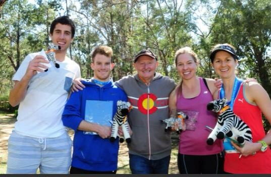 Winners of the Zebra Zoom (half marathon) show off their prizes.